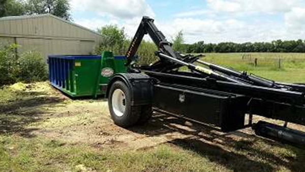 Delivery of 25 yard roll off dumpster by Heartland Recycling Services